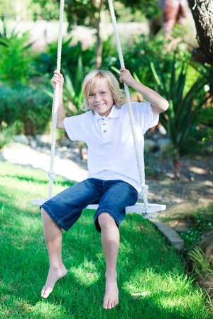 Child playing with a swing photo