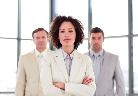 Confident young businesswoman in office photo