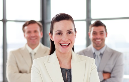Smiling businesswoman with folded arms in office photo