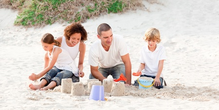 Family playing with the sand Stock Photo - 10249833