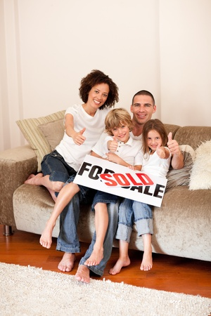 Young family sitting on a sofa Stock Photo - 10248896