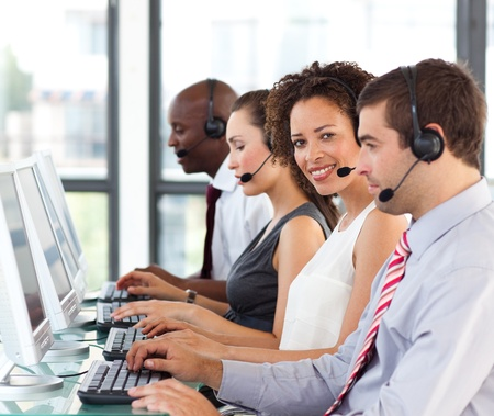 Ethnic businesswoman working in a call center photo
