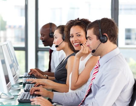 Smiling businesswoman working in a call center photo