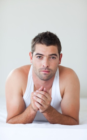 Attractive man lying in bed photo