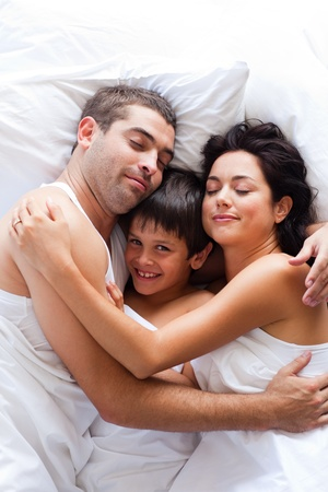 Happy family lying in bed Stock Photo - 10250350