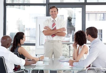 Senior Business man giving a presentation photo