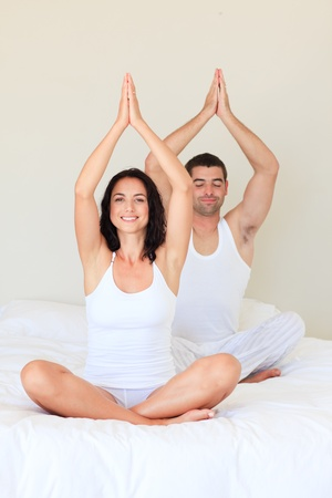 Couple doing exercises on bed photo