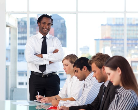 training group: Afro-American manager with folded arms working with his team