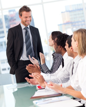 Business people clapping after a presentation Stock Photo - 10233925