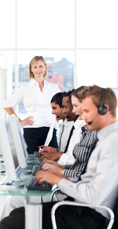 Female leader managing her team in a call center photo