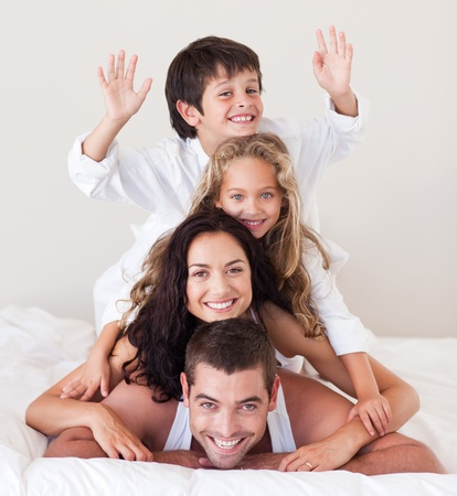 delighted: Delighted family lying on their bed