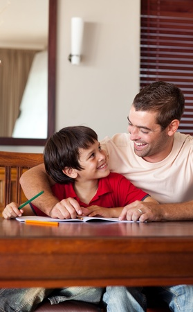 Handsome father helping his son for homework Stock Photo - 10249906