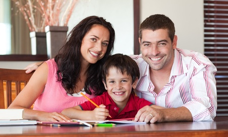 Lovely couple helping his son for homework photo