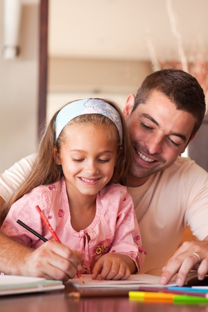male parent: Bright father helping her daughter for homework