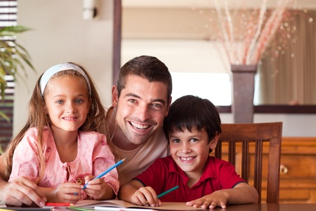 learning by doing: Radiant father helping his children for homework