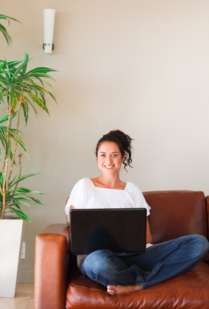 Woman using her laptop Stock Photo - 10250157