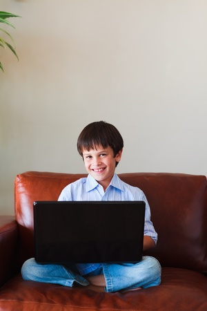 Child playing with his laptop photo