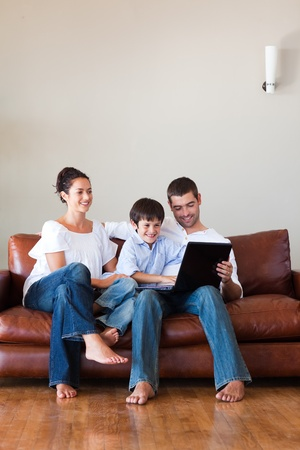 Parents and son playing with a laptop with copy-space Stock Photo - 10250491