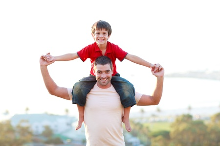 giving back: Father giving son piggyback ride