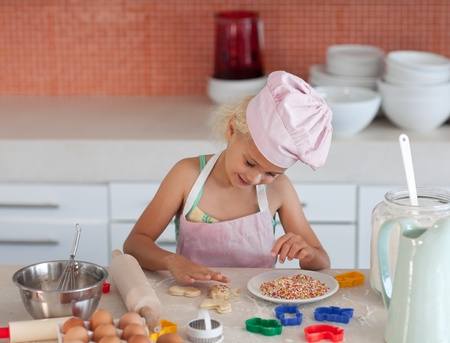Young daughter baking at home photo