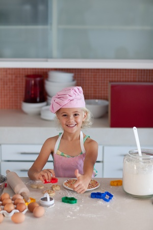 Young girl baking in a kitchen photo