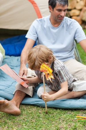 Father and son planting a flower Stock Photo - 10250396