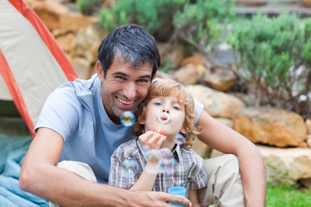 Father and son blowing bubbles photo