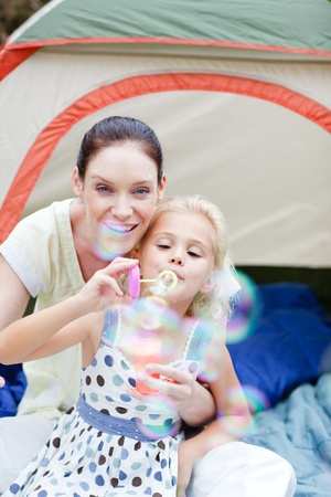 Mother and daughter together in tent Stock Photo - 10249844