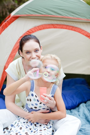 Mother and daughter blowing bubbles Stock Photo - 10250173