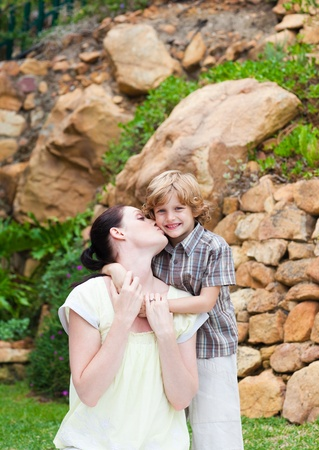 Mother kissing her son Stock Photo - 10248798