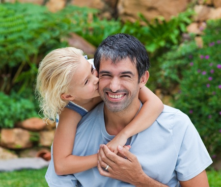 Daughter kissing her father Stock Photo - 10246142