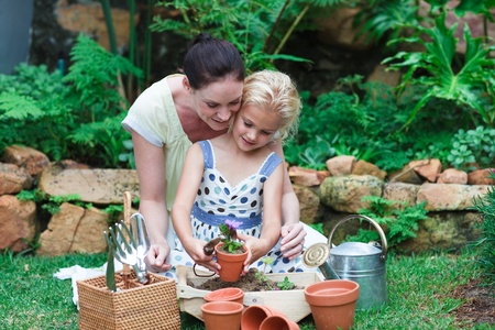 Lovely mother and daughter gardening  photo