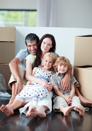 Famiy lying on floor after buying house Stock Photo - 10249814