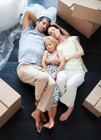 Parents and daughter sleeping on the floor Stock Photo - 10248666