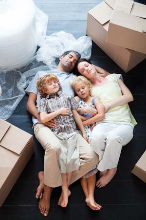 Beautiful family sleeping on the floor Stock Photo - 10248780