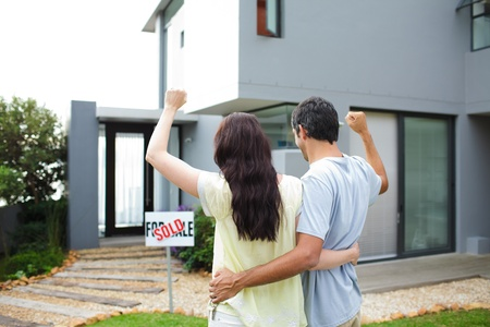 Happy couple after buying house Stock Photo - 10250150