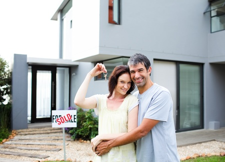 Happy couple after buying house photo