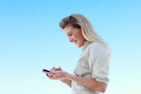 Attractive businesswoman writing a message against blue sky Stock Photo - 10246697