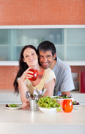 Lovers eating in the kitchen Stock Photo - 10248752