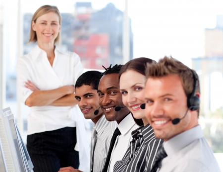 Business team in a call center with a bright female leader photo