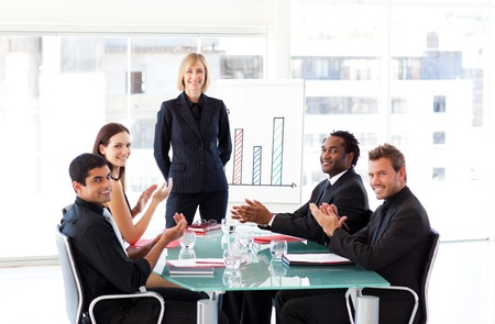 Business people applauding in a presentation Stock Photo