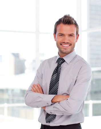 Handsome businessman with folded arms photo