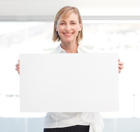 Beautiful woman holding empty white board photo
