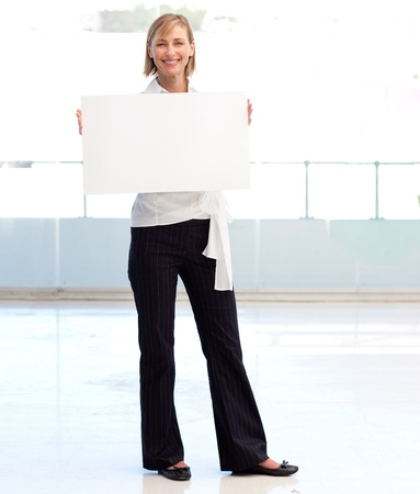 Businesswoman holding a white  card photo
