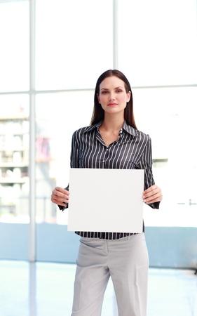 Businesswoman presenting a white  card photo