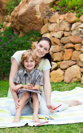 Mother and son painting in a park Stock Photo - 10249777
