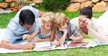 Happy family writing in a park photo
