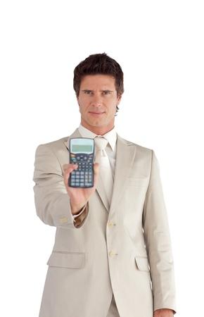Self-assured businessman holding a calculator photo