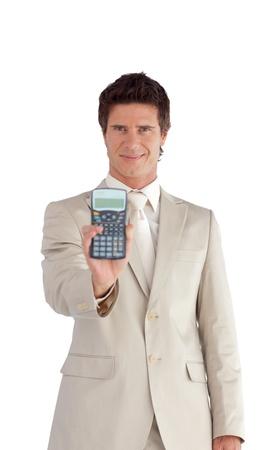 Confident businessman holding a calculator photo