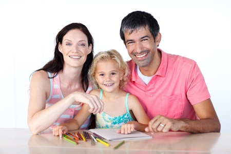 Parents and daughter drawing photo
